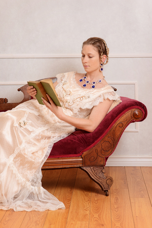 daybed: young victorian woman reading book