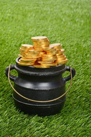 closeup pot of gold on grass