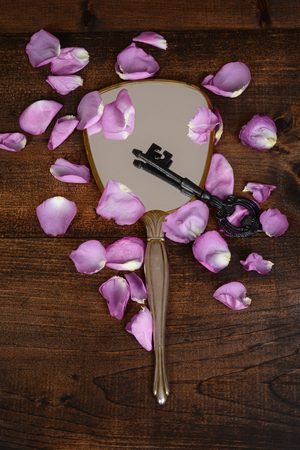 mirror with key and rose petals
