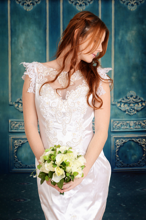 gown: bride with braids and flower bouquet
