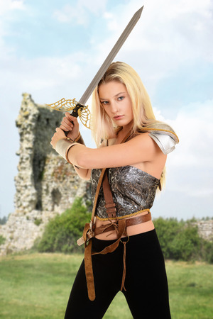 woman warrior with ruins in background Stock Photo