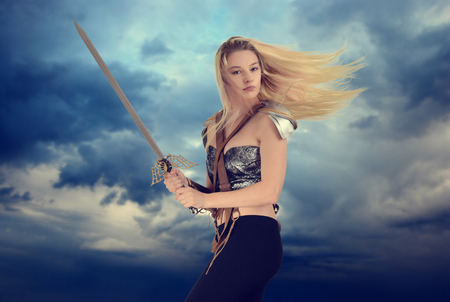 woman warrior with cloudy sky background