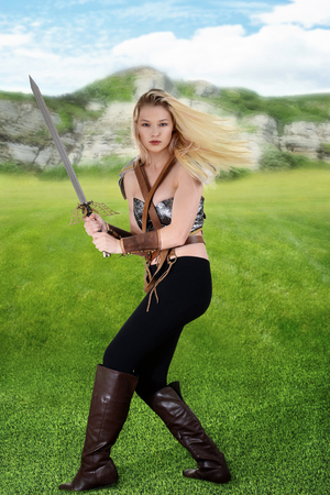 female warrior in a field Stock Photo