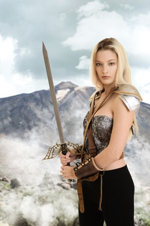 female warrior with sword and mountain in background Stock Photo
