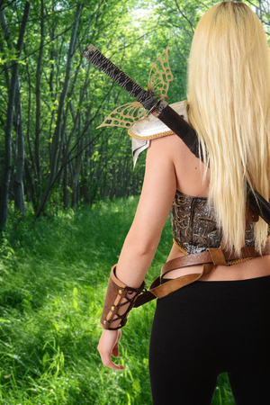 warrior woman walking in forest Stock Photo