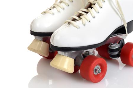 closeup women white quad roller skates