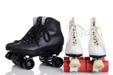 two pairs quad roller skates
