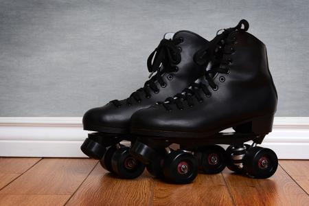 mens quad roller skates on wood floor Stock Photo