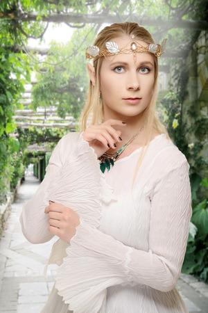 female elf in garden path Stock Photo