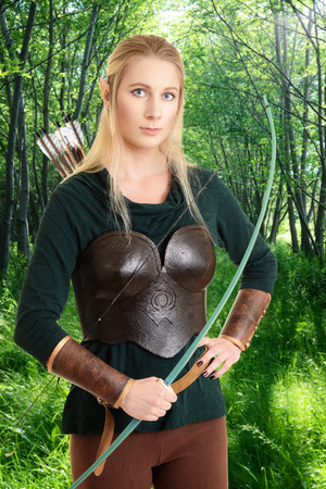 faerie: female elf with a green bow Stock Photo
