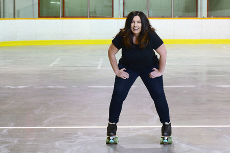 happy woman quad roller skating Stock Photo