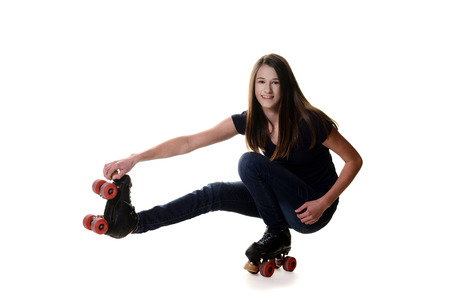 teen girl doing shoot the duck roller skate move