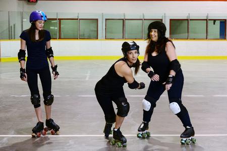 roller derby girls focus on center skater