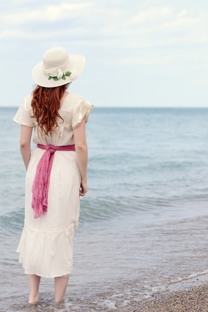 back of vintage woman at the seaside