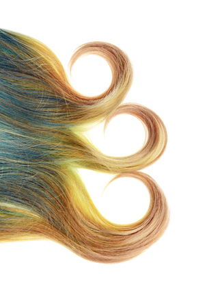 piece of blond and blue umbra hair with three curls isolated 스톡 콘텐츠