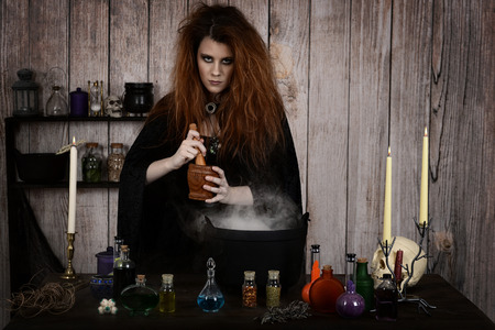 evil witch using mortar and pestle for her potion