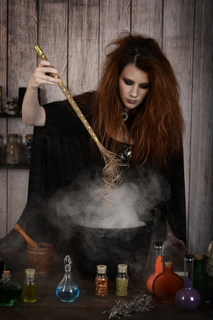 witch stirring her magic potion with her wand