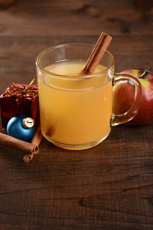 mug of apple cider with cinnamon stick