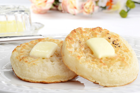 closeup english crumpets with melting butter 写真素材