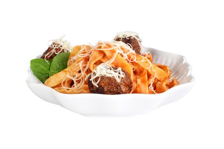 isolated spaghetti and meatballs with cheese