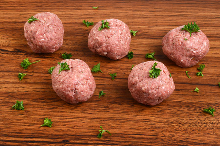 closeup raw meatballs with parsley Stock Photo