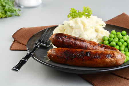 chorizo sausages with mashed potato and green peas