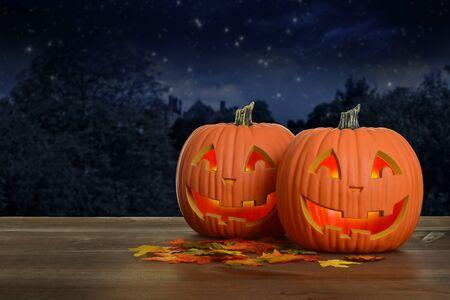 two Halloween pumpkins at night glowing Reklamní fotografie
