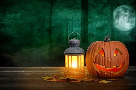halloween pumpkin and lantern on wood table