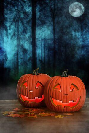 Halloween glowing pumpkins with fog 스톡 콘텐츠