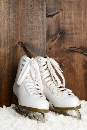 women ice skates with wood wall