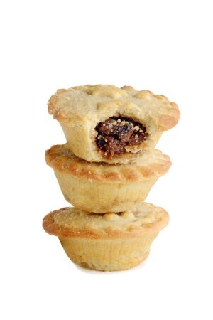 stack of mincemeat pies on white background