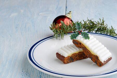fruit cake slices with christmas decorations Reklamní fotografie