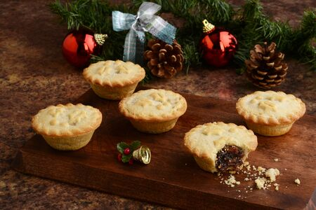 wood platter of christmas mincemeat pies Stock Photo