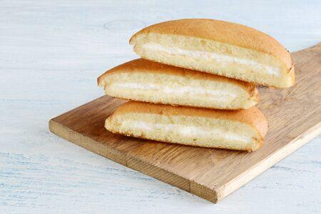stack of sponge cake slices with vanilla cream filling