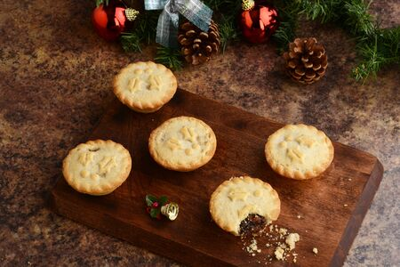 top view mincemeat pies with christmas decorations