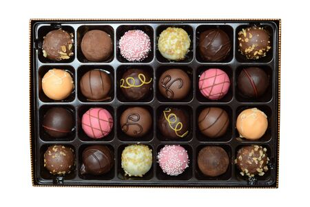 isolated assorted box of ball shaped chocolates