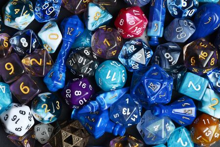 closeup of assorted d & d dice making a background