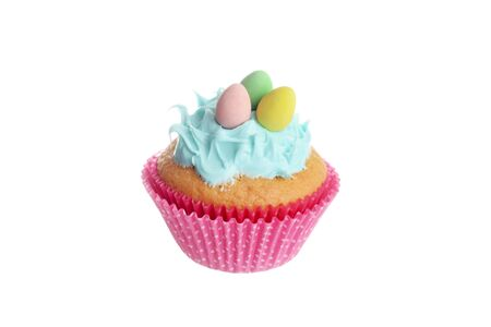 isolated easter cupcake with blue frosting and chocolate mini eggs Banco de Imagens