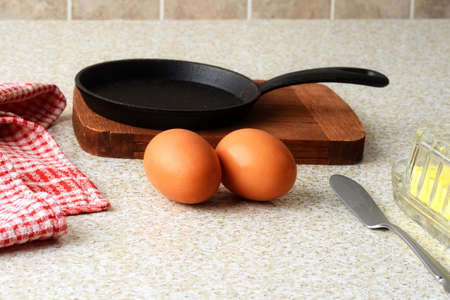 brown eggs with frying pan