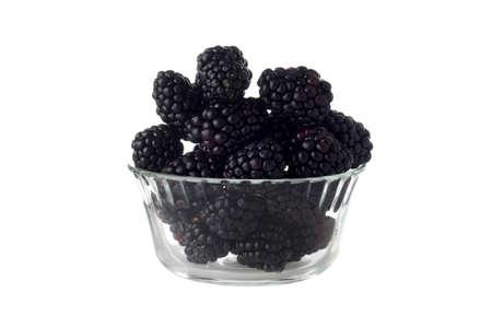 isolated glass bowl of blackberries