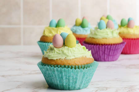 closeup easter cupcake with green frosting and eggs