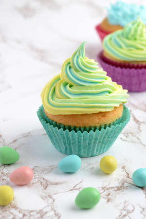 yellow and blue swirl easter cupcake