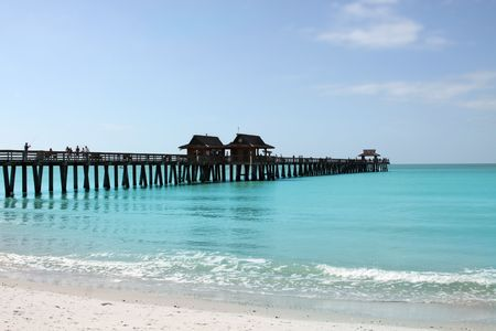 Sandy Beach and Fishing Pier in Gulf Of Mexico, FLorida USA