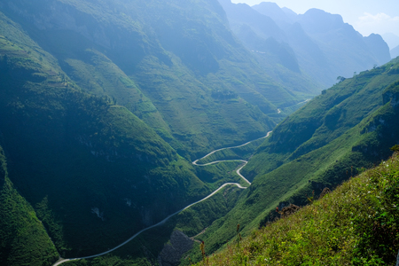 Winding roads through valleys and karst mountain scenery in the North Vietnamese region of Ha Giang / Dong Van.
