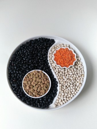 beans and lentils on the display with a separator in the form of Yin Yang. Flatley. foodfoto.