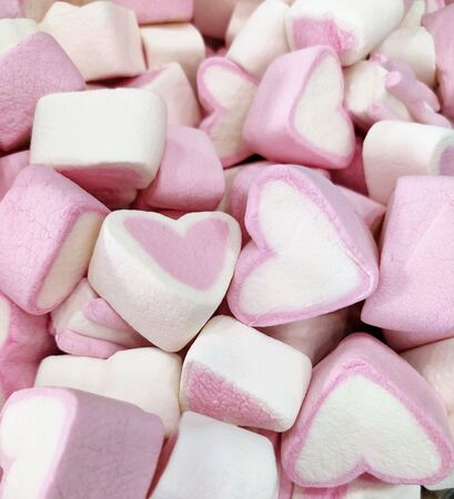 background of pink and white hearts marshmallow, sweet soft delicate mottled texture full space, top view, flat layout, love and Valentines day Reklamní fotografie