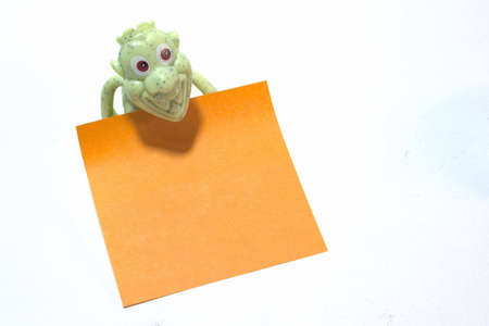 enquiry: Plastic toy holding the empty message paper.