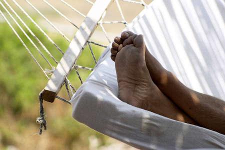 Man slipping on hammock photo