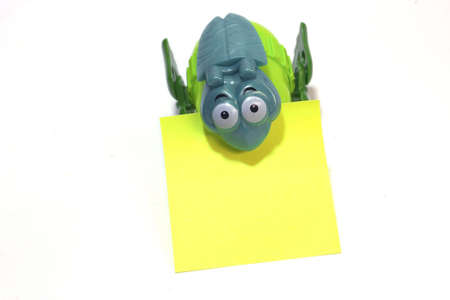 Plastic toy holding the empty message paper.