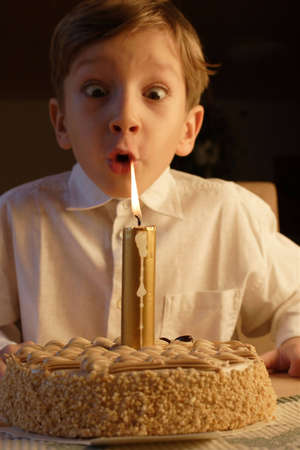 kid posing when blowing birthday candle. Stock Photo - 264084